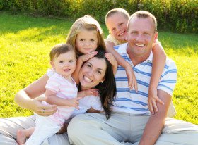 1347825028_happy-family-on-the-grass